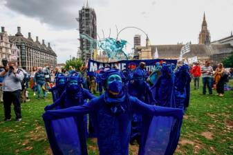 Members of the Ocean Rebellion group attend an Extinction Rebellion protest in London, Britain, September 6, 2020. REUTERS/Henry Nicholls