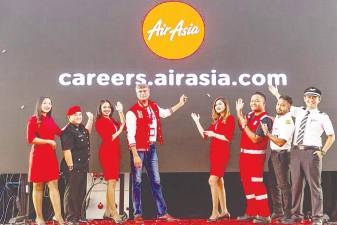 Bhatia (centre) with AirAsia Allstars at the launch of the airline's new career website at RedQ in Sepang.
