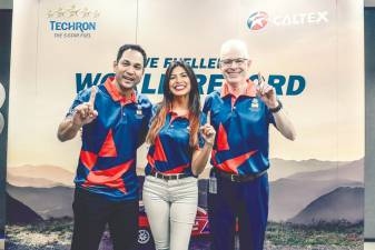 Thumbs up to Caltex with Techron and Clean & Glide Technology (from L) Hans, Chang and Engeler; for powering Chang to a new world record for fastest ascent up Doi Chang mountain in Thailand. — Sunpix by Adib Rawi