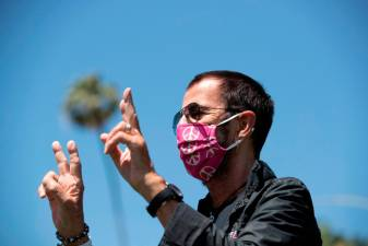 Musician Ringo Starr wears a face mask as he poses to celebrate his 80th birthday during the outbreak of the coronavirus disease (COVID-19), in Beverly Hills, California, U.S., July 7, 2020. REUTERS/Mario Anzuoni