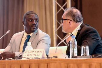 "Senegalese-American singer and songwriter Akon and his architect Hussein Bakri (R) attend a press conference in a hotel in Dakar, on August 31, 2020, to present plans to create a city named ""Akon City"". The rapper, whose real name is Alioune Badara Thiam, pledged to invest in tourism in his native Senegal where he spent his early childhood before moving to the US at age seven, where he later rose to superstardom. / AFP / Seyllou"