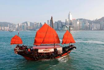 "A traditional wooden tourist junk boat ""Dukling"", sails in the waters of Victoria Harbour, during the COVID-19 pandemic, in Hong Kong, China October 31, 2020. Picture taken October 31, 2020. REUTERS/Tyrone Siu"