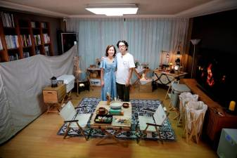 Lee Seung-yoon and his wife Che Min-hee pose for photographs after setting up camping gear during a staycation at their home amid the coronavirus disease (COVID-19) pandemic, in Seoul, South Korea, August 22, 2020. Picture taken on August 22, 2020. REUTERS/Kim Hong-Ji