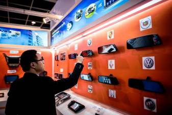 A man trying out a gadget on display at an electronics fair in Hong Kong. Hong Leong Investment Bank said global semiconductor sales for the first 11 months of 2018 were outstanding. AFPPIX