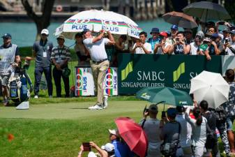 Matt Kuchar of the US tees off during the third round of the Singapore Open at Sentosa golf club in Singapore on January 19, 2020. - AFP
