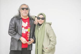 Ramli Sarip and Ella walk down memory lane. -ADIB RAWI/THESUN