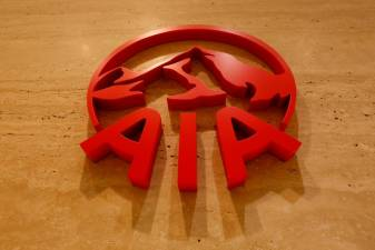 AIA logs slowest new business growth since listing, sees virus hitting sales 1