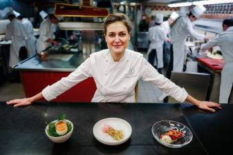 French pastry chief Jessica Prealpato of the Plaza Athenee hotel poses in her restaurant's kitchen for a portrait in Paris on June 6, 2019. Prealpato was named as the 2019 Best Restaurant Pastry Chef by the World's 50 Best Restaurants on June 9, 2019./ AFP / LUCAS BARIOULET