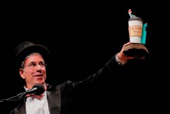"Master of Ceremonies Marc Abrahams, editor of the ""Annals of Improbable Research,"" holds up the 2019 Ig Nobel Award at the 29th First Annual Ig Nobel Prize Ceremony at Harvard University in Cambridge, Massachusetts, U.S., September 12, 2019. REUTERS/Brian Snyder"