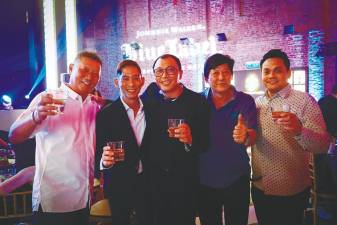 At the launch ... Diageo Malaysia brand ambassador Jeremy Lee (second from left) and Moet Hennessy Diageo Malaysia senior sales manager Jesse Lim (centre) along with party guests.