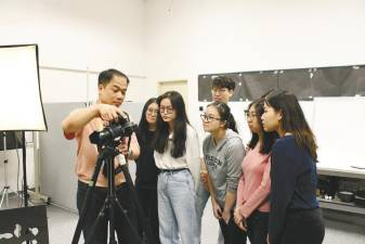 Diploma in Graphic Design students using the Photography Studio for one of their study modules.