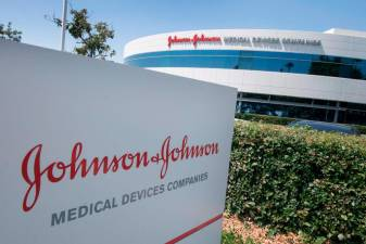 (FILES) In this file photo taken on August 28, 2019 an entry sign to the Johnson & Johnson campus shows their logo in Irvine, California on August 28, 2019.- AFP
