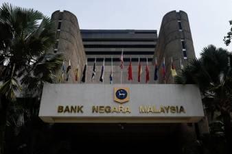 Bank Negara cuts benchmark rate to near decade low 1