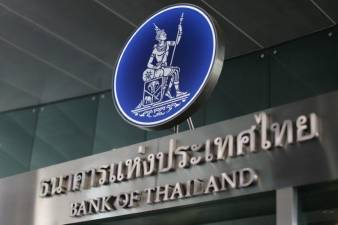 Thai central bank unexpectedly cuts key rate, worried by baht strength