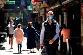 People walk down a city laneway after coronavirus disease (Covid-19) restrictions were eased for the state of Victoria, in Melbourne, Australia, October 28, 2020. — Reuters