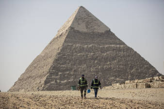 Workers clean and disinfect areas near Egypt's pyramids, emptied of tourists during the pandemic. Egypt's Ministry of Tourism and Antiquities has launched a series of virtual and guided video tours of museums and archaeological sites around the country.