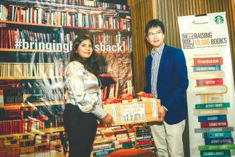 Project lead Apshy (on left), and Ideas' Tunku Zain at the launch of The Book Effect. . – ADIB RAWI YAHYA/THESUN