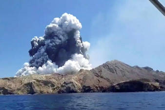 Smoke from the volcanic eruption of Whakaari, also known as White Island, is pictured from a boat, New Zealand Dec 9, 2019. — Screengrab courtesy of @allessandrokauffmann via Reuters