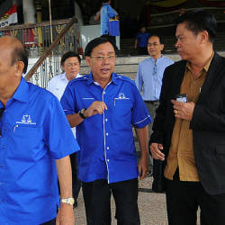 Filepix shows Datuk Seri Dr Stephen Rundi Utom (center) at the Parti Pesaka Bumiputera Bersatu (PBB) main office on April 21.