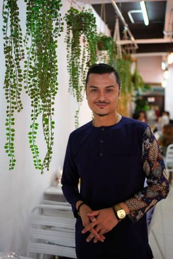Fazley with an array of delicious Negeri Sembilan food at MinangKapau restaurant. – NORMAN HIU/THESUN