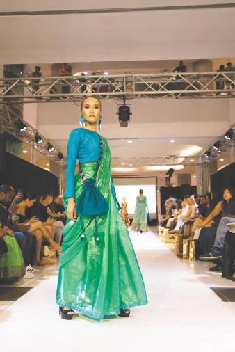 Roovaa Lijuan's designer sarees showcased in a fashion show. – Courtesy of Roova Lijuan