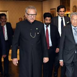 Prime Minister Tun Dr Mahathir Mohamad walks with Pakistan President Dr Arif Alivi (L) during a courtesy call at President's House on March 23, 2019. — Bernama
