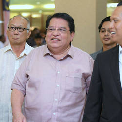 Filepix taken on July 3 shows Datuk Seri Tengku Adnan Tengku Mansor (center) at the Kuala Lumpur High Court. — BBXpress
