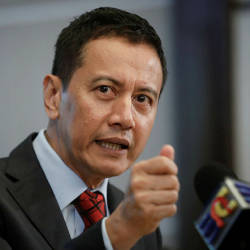 EC chief denies discussing Rafizi's case with AG
