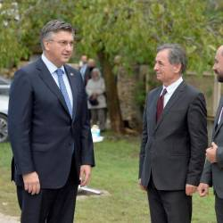Croatian Prime Minister Andrej Plenkovic (Left), President of the Serbian People's Party Milorad Pupovac (Centre), and Deputy Prime Minister of Croatia in charge of social affairs and human and minority rights Boris Milosevic (Right) attend a ceremony to in commemoration of ethnic Serb civilians killed in the aftermath of the country's 1990s independence war in Varivode on Sept 28, 2020. — AFP
