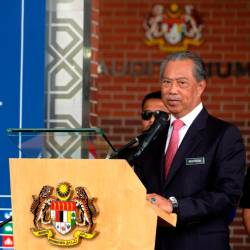 Home Minister Tan Sri Muhyiddin Yassin speaks during the flagging-off the East Coast Post-Disaster Humanitarian Mission convoy in Putrajaya today. - Bernama