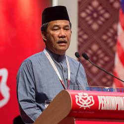 Umno deputy president Datuk Seri Mohamad Hasan speaking at the 2019 Umno general assembly at the Putra World Trade Centre yesterday. — Bernama