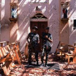 Sri Lankan military stand guard inside a church after an explosion in Negombo, Sri Lanka April 21, 2019. — Reuters