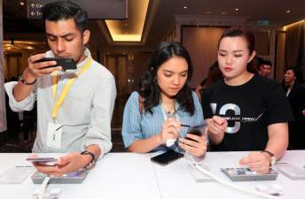 At the media event ... Members of the media exploring the various features of the upcoming Samsung Galaxy Note10. – MASRY CHE ANI/THESUN