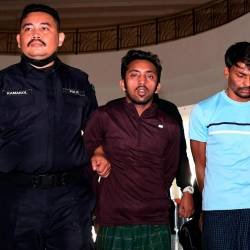 Two Myanmar workers, Hamid Husin Mohd Husin, 32, and Mohd Karim Hosain, 28, were charged in the Kuantan magistrate's court today on charges of killing their Bangladeshi supervisor, Abdul Kader, 40. - Bernama