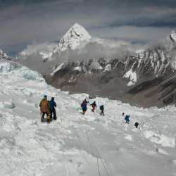 In this file photo taken on April 29, 2018, mountaineers walk near camp one of Mount Everest, as they prepare to ascend on the south face from Nepal. - AFP