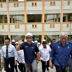 Education Minister Dr Maszlee Malik (front, second from right) visiting the site of the new administrative building and classroom project of Sekolah Menengah Kebangsaan Sungai Tapang today. — Bernama