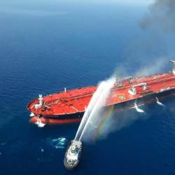A picture obtained by AFP from Iranian news agency Tasnim on June 13, 2019 reportedly shows an Iranian navy boat trying to control fire from Norwegian owned Front Altair tanker said to have been attacked in the waters of the Gulf of Oman. - AFP
