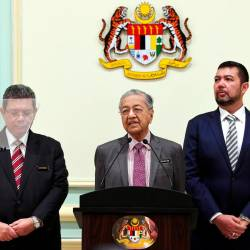 From left: Foreign Minister Datuk Saifuddin Abdullah, Prime Minister Tun Dr Mahathir Mohamad, and Deputy Foreign Minister Datuk Marzuki Yahya, at the launch of the Foreign Policy Framework of the New Malaysia, on Spet 18, 2019. — Bernama