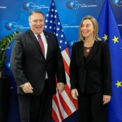 U.S. Secretary of State Mike Pompeo poses with European Union foreign policy chief Federica Mogherini in Brussels, Belgium, on Feb 15, 2019. — Reuters