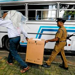 Sri Lankan police and election officials load ballot boxes and papers into busses from a distribution center to polling stations, ahead of country's presidential election scheduled on Nov 16, in Colombo, Sri Lanka. — Reuters