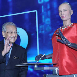Prime Minister Tun Dr. Mahathir Mohamad waves his hand to Sophia 'The Robot' after the official opening ceremony on Beyond Paradigm Summit 2019 at MITEC today.