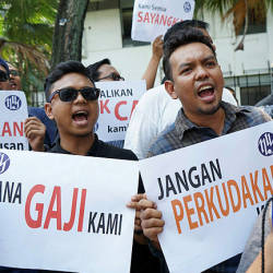 About 100 Utusan Melayu workers held a protest today outside its headquarters. — Sunpix by Zulfkifil Ersal
