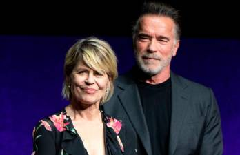 "In this file photo taken on April 04, 2019 Actors Linda Hamilton (L) and Arnold Schwarzenegger speak on stage during the CinemaCon Paramount Pictures Exclusive Presentation at the Colosseum Caesars Palace in Las Vegas, Nevada. A smorgasbord of sequels, prequels and reunions from ""Terminator"" to ""Game of Thrones"" awaits thousands of misty-eyed comic book geeks and sci-fi nerds descending on San Diego this week for the world's largest celebration of pop culture fandom. / AFP / VALERIE MACON"