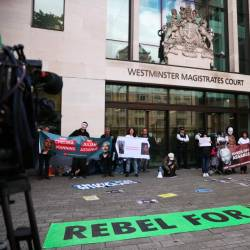Demonstrators protest outside of Westminster magistrates court, where a case hearing for US extradition of Wikileaks founder Julian Assange is held, in London, Britain, June 14, 2019. - Reuters