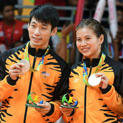 Silver medalists Liu Ying Goh and Malaysia's Peng Soon Chan stand with their medals on the podium following the mixed doubles Gold Medal badminton match at the Riocentro stadium in Rio de Janeiro on Aug 17, 2016, at the Rio 2016 Olympic Games. — AFP