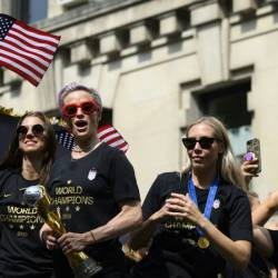 In this photo taken on July 10, 2019 Megan Rapinoe (C) and other members of the World Cup-winning US women's team take part in a ticker tape parade in New York. — AFP