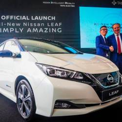 Nissan Asia & Oceania senior vice-president Vincent Wijnen (at right) with ETCM sales and marketing director Christopher Tan unveiling the all-new, second-generation Nissan Leaf to the crowd, this morning.
