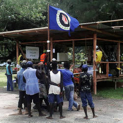 Filepix showing residents hold a Bougainville flag at a polling station during a non-binding independence referendum in Arawa, on the Papua New Guinea island of Bougainville Nov 26, 2019 — Reuters