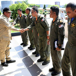 Defence Minister Mohamad Sabu (two, left) greets pilots at the Wilayah Laut 1 navy Headquarters in Tanjung Gelang, on July 16.