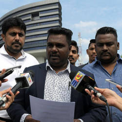 PKR Youth vice–chief Thiban Subramaniam (center) when met at a press conference in front of the Malaysian Anti–Corruption Commission today.